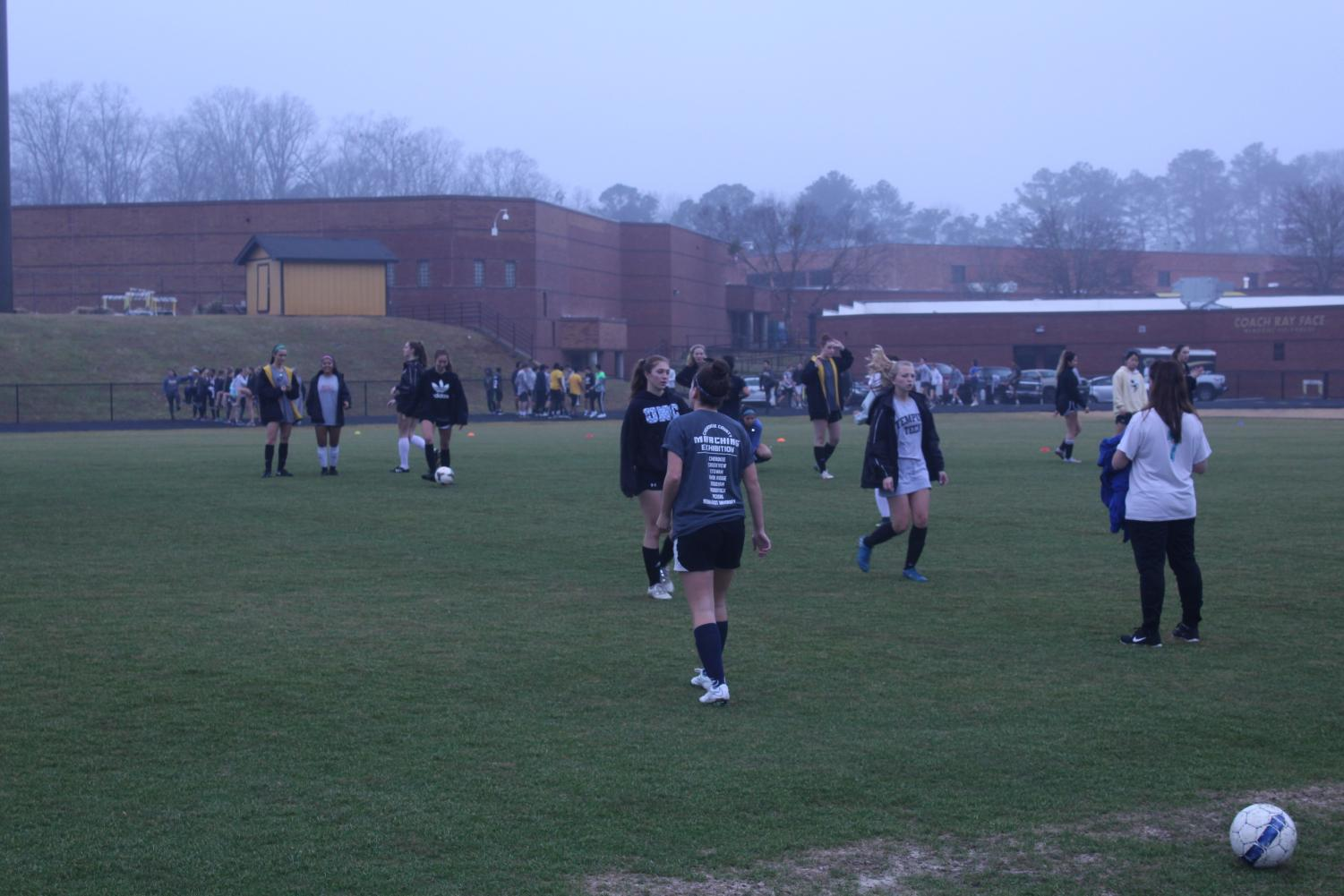 The girls soccer team tryout with the dark sky overhead. Tryouts were rescheduled for January 20-22, with the results posted on Thursday afternoon.