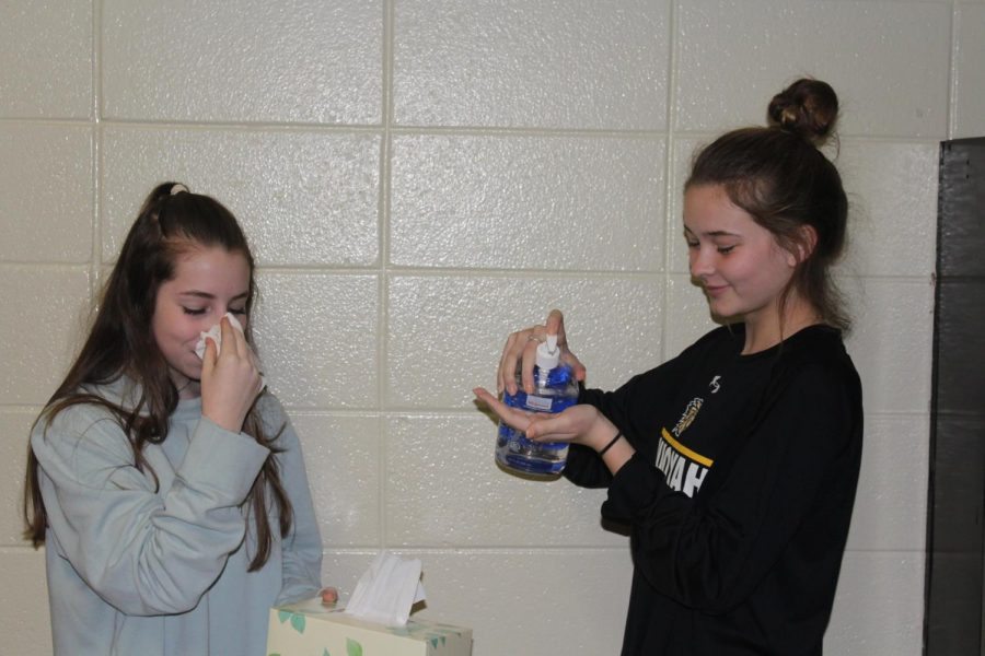 Sophomore+Gabby+Troche+and+sophomore+Madi+Foley+relive+their+experience+with+the+flu.+Unfortunately%2C+our+sanitized+journalism+room+could+not+protect+them+from+getting+the+flu.++