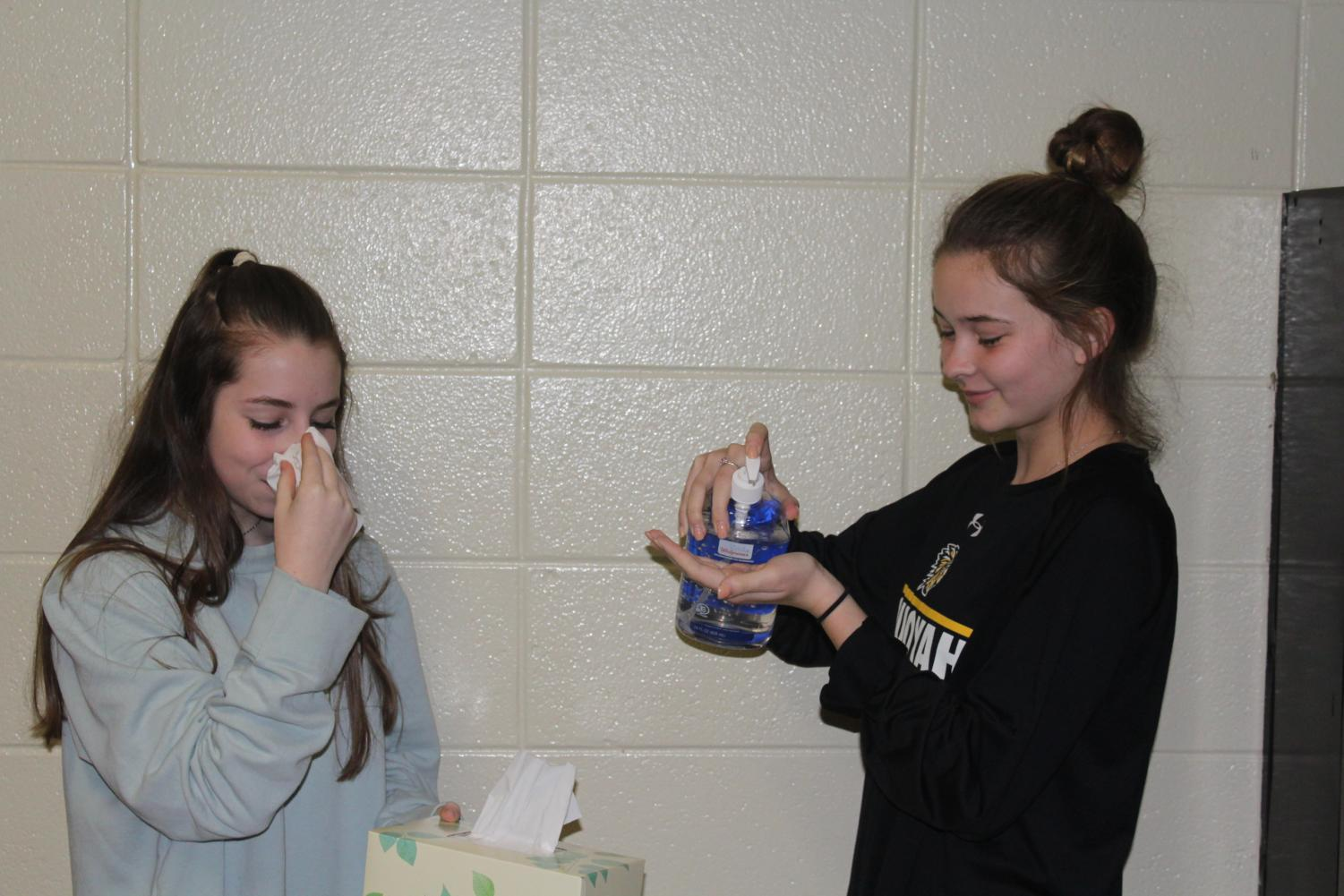 Sophomore Gabby Troche and sophomore Madi Foley relive their experience with the flu. Unfortunately, our sanitized journalism room could not protect them from getting the flu.