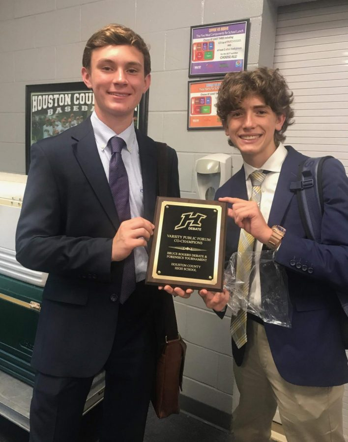 Juniors+Patrick+McKenzie+and+Andrew+Doerr+show+off+their+plaque+at+the+Bruce+Rogers+tournament+at+Houston+County+high+school+on+September+8%2C+2018.+McKenzie+and+Doerr+have+been+on+the+debate+team+for+three+years.