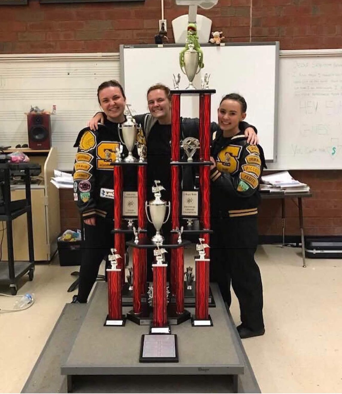 Senior Hannah Becker, junior Cassie Myers, and senior Mackenzie Weston show off the Grand Champion award from the Greater Atlanta Marching Festival on Oct. 13, 2018. Becker, Myers, and Weston worked hard to become drum majors this year.