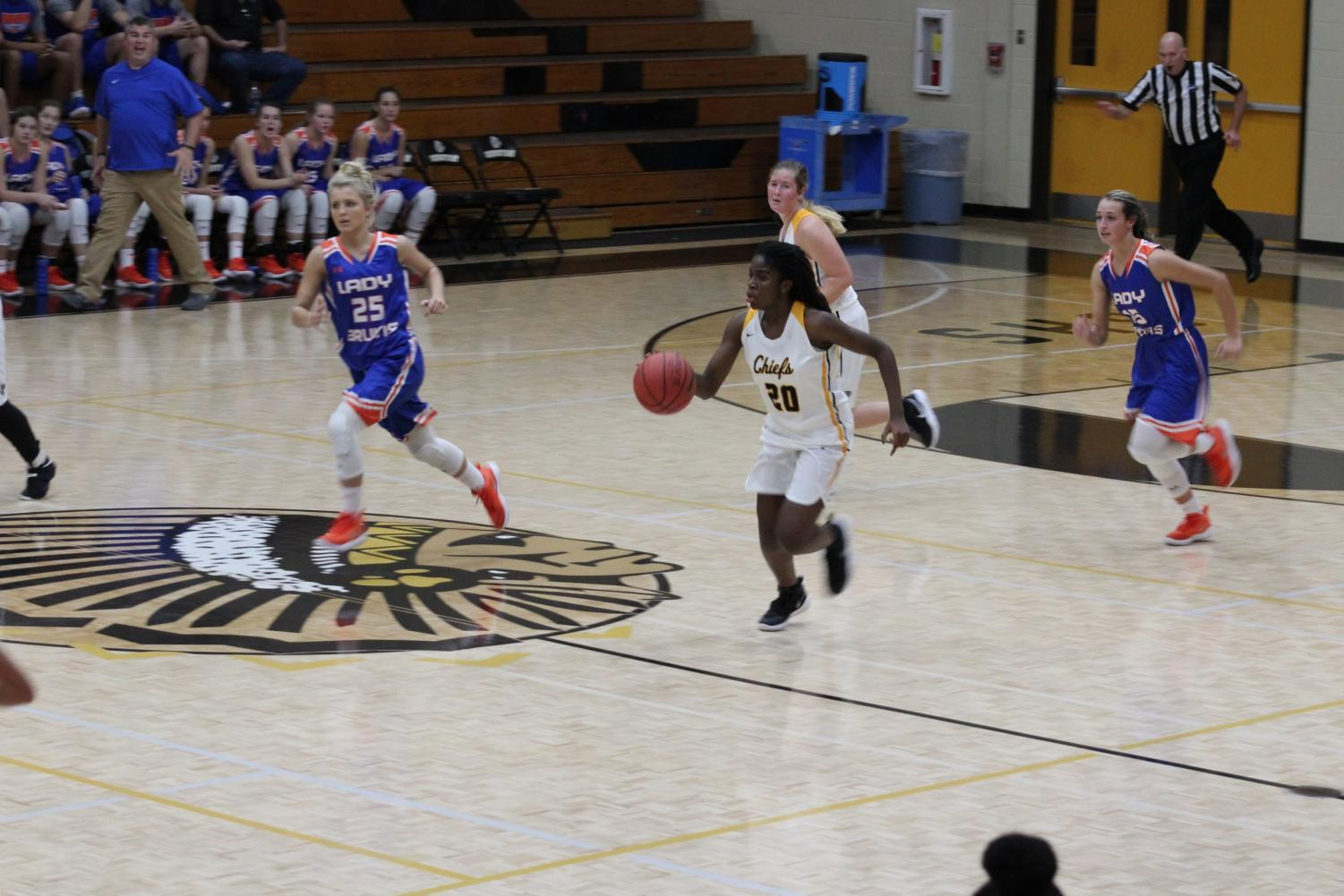 Senior Sydney Rosant dribbles down the court on a fast break. Rosant led the team to a first-round playoff win against Alpharetta.