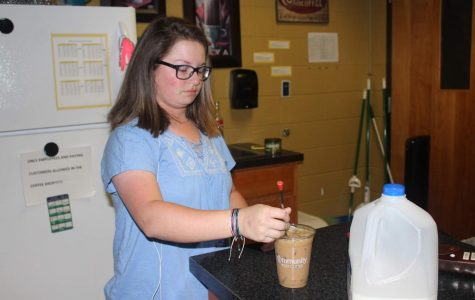 Students serve coffee with a smile
