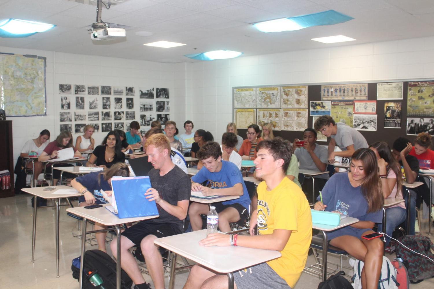 Mr. Andy Maxwell's sixth period US History class listens along during a lecture. Last year Mr. Maxwell's largest class had fewer than 30 students, but this year almost all his classes have over 30 students. Photo by Emily Hill