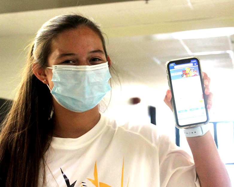 Caroline Small poses with ClickList on her phone. She began using the Kroger prior to the pandemic.