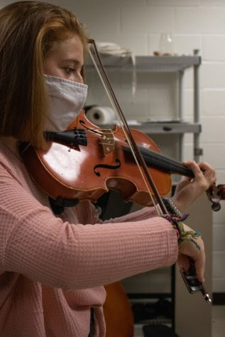 Carsyn Campbell practices Eine Klein Nachtmusik with the chamber group. She earned the position of first chair viola in the orchestra.