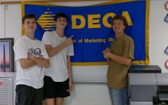 Juniors Evan Case, Nick Levantis, and Ryder Moye are DECA members. DECA has found ways to make their meetings safe and socially distant.