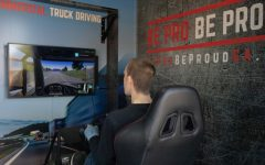 A student uses an 18-wheeler simulator to experience what it is like to drive one. Be Pro Be Proud wants to give students the chance to learn more about the workforce.