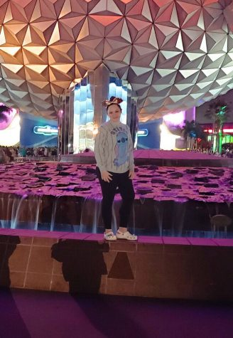 Woodall stands in front of the Epcot ball.