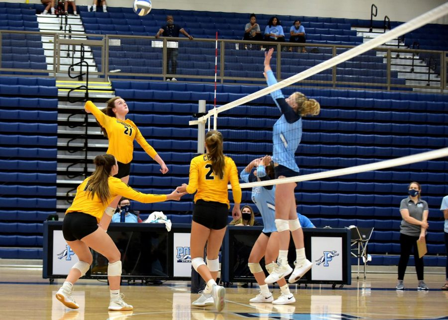 Sarah Siefert plays the ball during their home game. Siefert has played the position of outside hitter for 8 years.