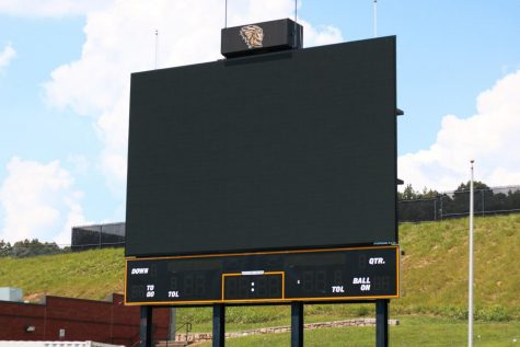 The newly placed scoreboard stands tall at the end of the football field. The scoreboard's installation was pushed back a year.