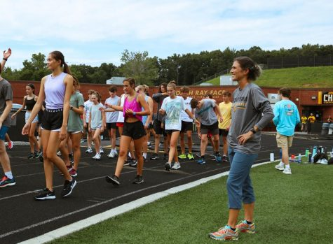 Coach Ingram oversees the warm-ups of the Cross Country team. Ingram has high expectations for her runners this season.