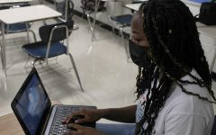 Cayla Johnson signs on to her computer to start work. She enjoyed her online learning experience and would consider doing it again in the future.