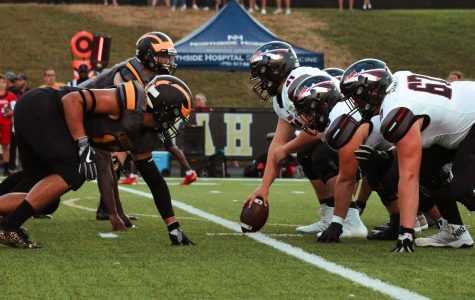 Football linemen line up prior to the snap. The football team beat Cass 37-23 on Sept. 3.