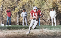 Rook runs a route. Coach Collins played football during his high school years.